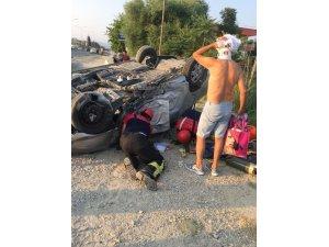 Karı koca takla atan otomobilde yaralandı