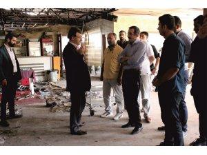 Başkan Türkmenoğlu'ndan yangında hasar gören iş yerlerine ziyaret