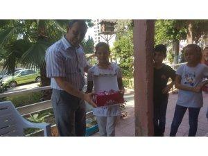 Gazilerden muhtaç çocuklara kırtasiye ve ayakkabı yardımı