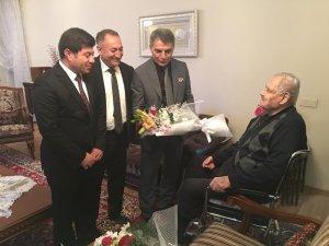Kaymakam Özkan'dan emekli öğretmene ziyaret