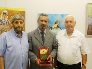 Cumali Karataş'a  onursal üyelik ve plaket verildi