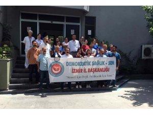 Sağlık çalışanlarından bantlı tepki