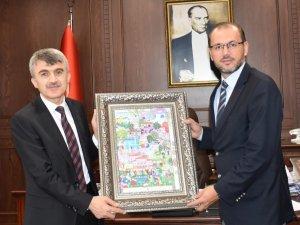 DPÜ Rektörü Uysal'dan, AFSÜ Rektörü Okumuş'a nezaket ziyareti
