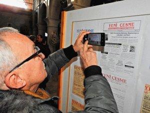 Çeşme'deki yerel gazete önemli baş sayfalarından sergi açtı