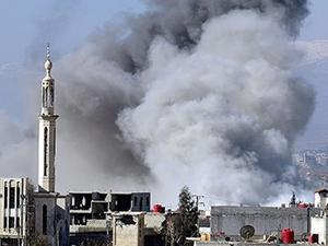 Esad'ın uçakları Irak'ı vurdu!