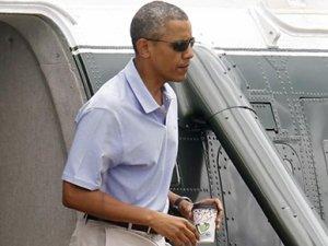 Dünya kaynıyor, Obama golf oynuyor