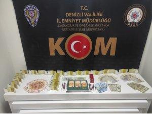 Döviz bürolarındaki eskimiş paraları sahte para yapımında kullanan 2 şüpheli yakalandı