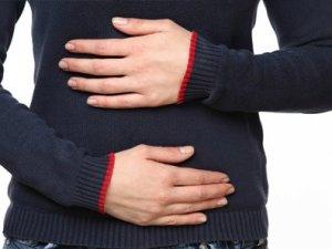 Karın ve sırt bölgesindeki şiddetli ağrıya dikkat