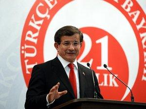 Başbakan Davutoğlu: Bir Türk bayrağı Kur'an-ı Kerim meali ve Türkçe sözlük vereceğiz