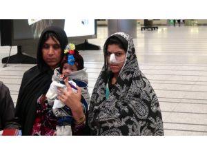 Burnu kesilen kadın tedavi için Türkiye'de