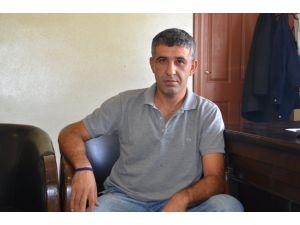 Hakkında tutuklama kararı olan DBP'li belediye başkanı görevinden azledildi
