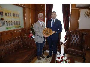 Ateş'ten İzmir Valisi Toprak'a Ziyaret