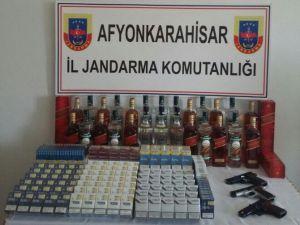 Sandıklı'da Ruhsatsız Silah, Kaçak Sigara Ve İçki Ele Geçirildi