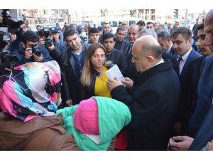 Başbakan Yardımcısı Fikri Işık esnafı ziyaret etti