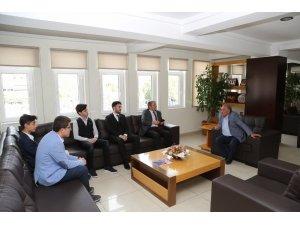 Dünya birincilerinden başkan Özkan'a ziyaret