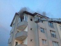 Balkonda otururken evlerinin yandığını öğrendiler