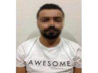Aranan FETÖ üyesi sahte kimlikte paylaşım yaparken yakalandı