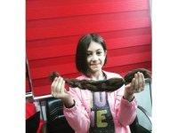 10 yaşındaki Kerime Ela saçlarını kanser hastaları için kestirdi