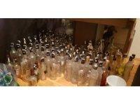 Isparta'da sahte içki üretimi yapılan evden cephanelik çıktı