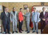 AÇSH Bakan Yardımcısı Koca, başarılı sporcuyu ödüllendirdi