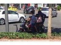 5 kişilik ailenin motosikletle tehlikeli yolculuğu