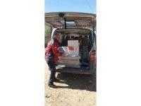 Taşköprü'de evi yanan ailelere Kızılay'dan yardım