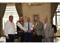 Başkan Çerçi'den güreşlere kırmızı dipli mumla davet
