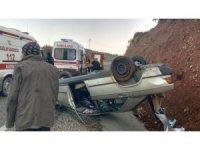 Manisa'da otomobil takla attı, 2 kişi ölümden döndü