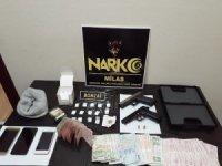 Milas'ta uyuşturucu, silah ve para ele geçirildi