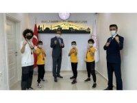 Karatede derece yapan öğrenciler, Ekinci'yi ziyaret etti