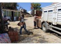 Yangınzede ailelere inşaat malzemesi desteği
