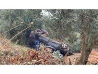 Bursa'da kanala uçan araç takla attı, içindekiler burnu kanamadan kurtuldu
