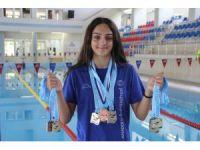 14 yaşındaki genç sporcunun 63 madalyası bulunuyor