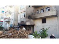 Odunluk yangını binaya sıçramadan söndürüldü