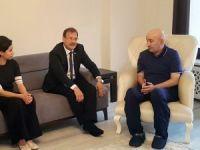 Başbakan Yardımcısı Çavuşoğlu, 15 Temmuz kahramanı Turgut Aslan'ı ziyaret etti