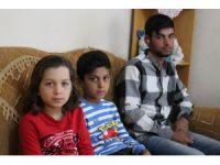 Suriyeli sağır kardeşler güvercinlerinin sesini duymak istiyor