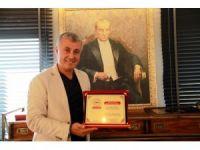 KAMUDER'den Başkan Sözen'e ödül