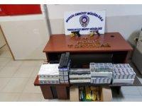 Mersin'de, otoparkta ruhsatsız tabanca ile gümrük kaçağı sigara ele geçirildi