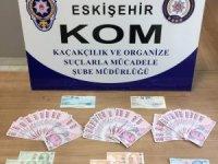 Eskişehir'de kalpazanlar sahte 10 bin lirayı piyasaya sürmek isterken yakalandı