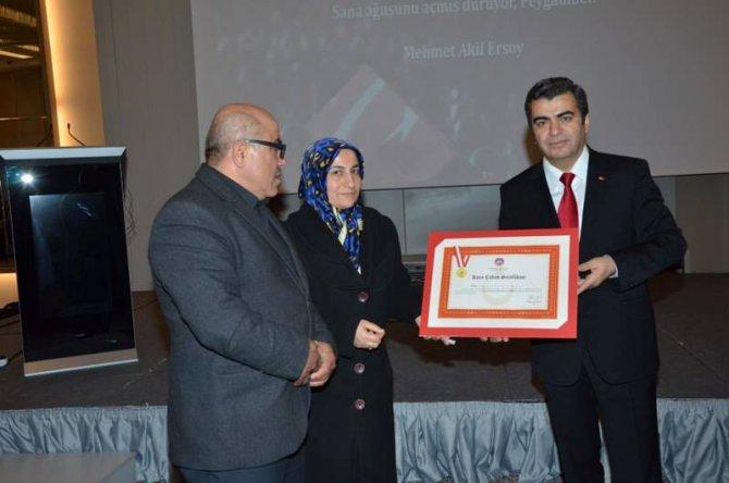 Kayseri'de bir hayırsever 14 şehit ailesine ev hediye etti
