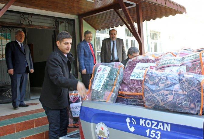 Kozan'dan Bayır Bucak Türkmenlerine kışlık malzeme yardımı