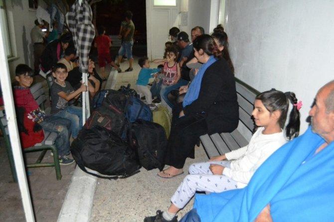 Ayvalık'ta Sahil Güvenlik, Jandarma ve KOM ekiplerinden ortak operasyonla 6 insan taciri ve 39 göçmen yakalandı