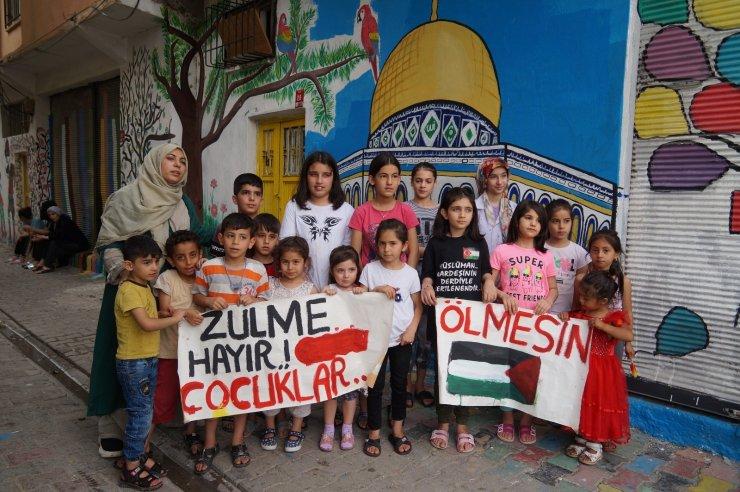 İsrail'in Filistin'e zulmünü çizdikleri resimle protesto ettiler