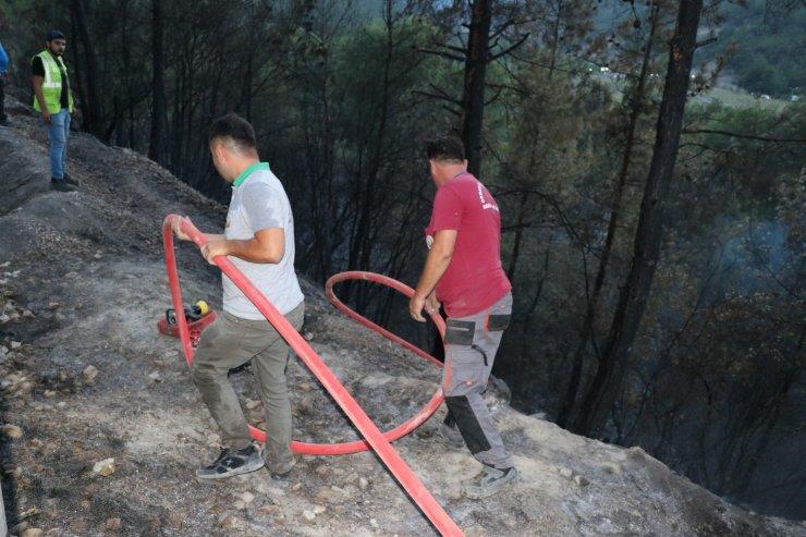 Orman yangını kontrol altına alındı, soğutma çalışmaları sürüyor